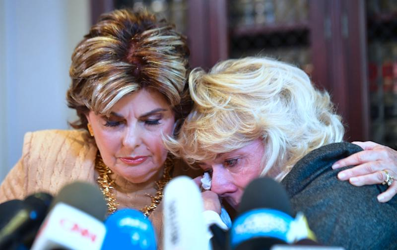 Heather Kerr, right, reacts after alleging in a news conference that she was sexually harassed by film producer Harvey Weinstein. Attorney Gloria Allred is at her side.