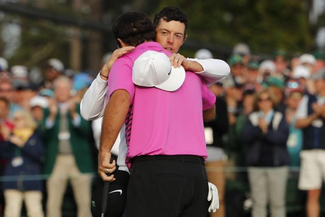 Rory McIlroy of Northern Ireland (rear) congratulates Patrick Reed of the U.S. after Reed won the 2018 Masters tournament following final round play at the Augusta National Golf Club in Augusta, Georgia, U.S. April 8, 2018. REUTERS/Jonathan Ernst