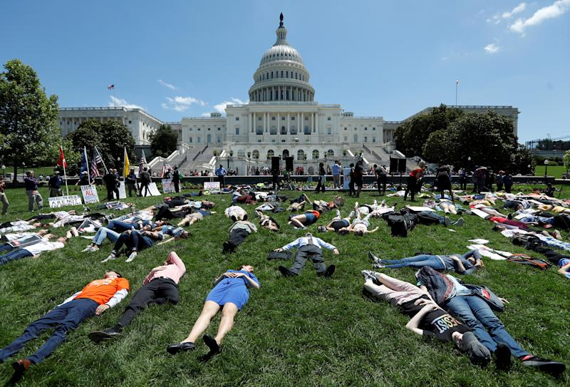 Activists mark the second anniversary of the Pulse Nightclub shooting where a gunman killed 49 people in Orlando with a die-in at the U.S. Capitol in Washington, U.S., June 12, 2018.   Kevin Lamarque—Reuters