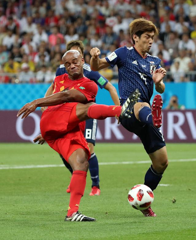 <p>Belgium's Vincent Kompany in action with Japan's Yuya Osako REUTERS/Marko Djurica </p>