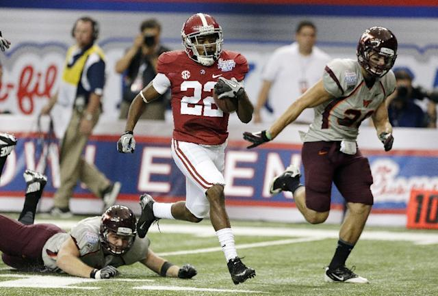 Alabama wide receiver Christion Jones (22) runs past Virginia Tech defensive end Matt Roth (91) and linebacker Chase Williams (36) on a touchdown run from a punt return during the first half of an NCAA college football game, Saturday, Aug. 31, 2013, in Atlanta. (AP Photo/Dave Martin)