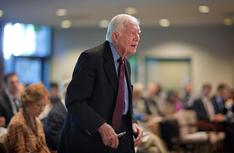 Former President Jimmy Carter steps to the podium to discuss U.S. election reform at the Carter Center, Wednesday, July 17, 2013, in Atlanta. Carter gave the keynote remarks Wednesday along with Ambassador Janez Lenarcic of the Warsaw-based Office for Democratic Institutions and Human Rights. The organization is presenting its final report for improving the U.S. electoral process. (AP Photo/David Goldman)