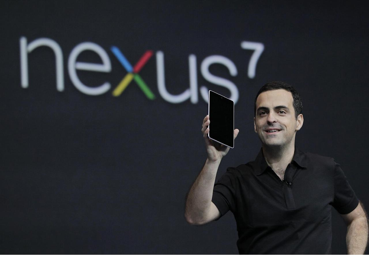 Hugo Barra, Director of Google Product Management, holds up the new Google Nexus7 tablet at the Google I/O conference in San Francisco, Wednesday, June 27, 2012. (AP Photo/Paul Sakuma)