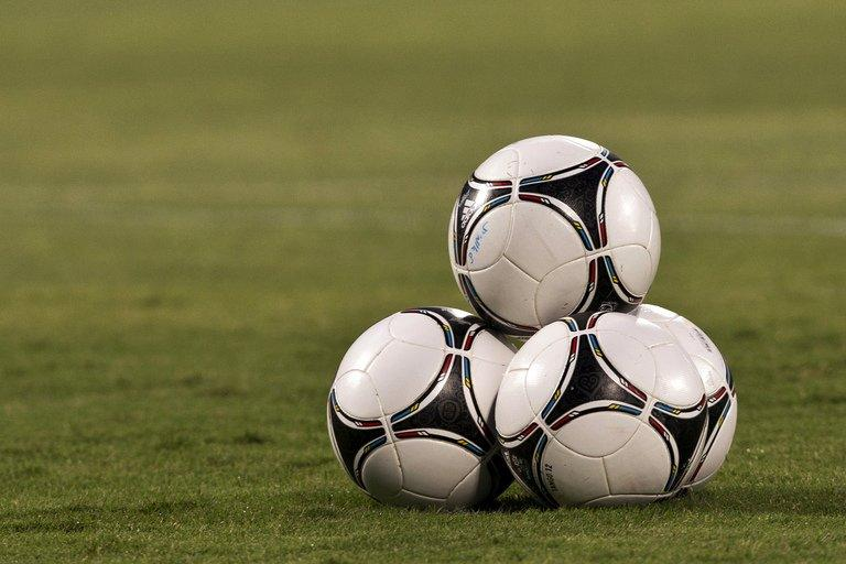 A picture taken on October 16, 2012, shows footballs before the start of a FIFA 2014 World Cup qualifier, near Tel Aviv
