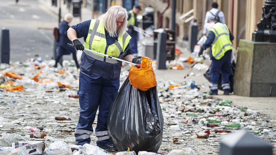 Workers, pictured here clearing litter in the centre of Leeds.