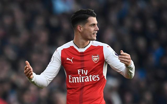<span>Granit Xhaka is in the teeming 'stagnant' or 'regressed' category at Arsenal</span> <span>Credit: Dylan Martinez/REUTERS </span>