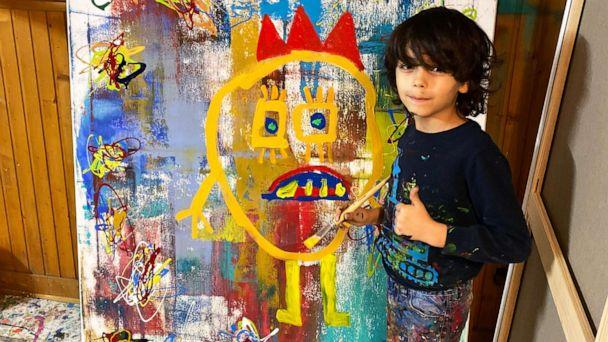 PHOTO: Mikail Akar, 7, with one of his original works at his home studio. (Courtesy Kerem Akar)