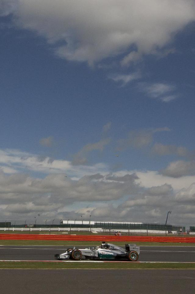 Mercedes driver Lewis Hamilton rounds the track during a practice session before the British Formula One Grand Prix at Silverstone, England, Friday, July 4, 2014. The British Formula One Grand Prix will be held on Sunday, July 6, 2014. (AP Photo/Jon Super)