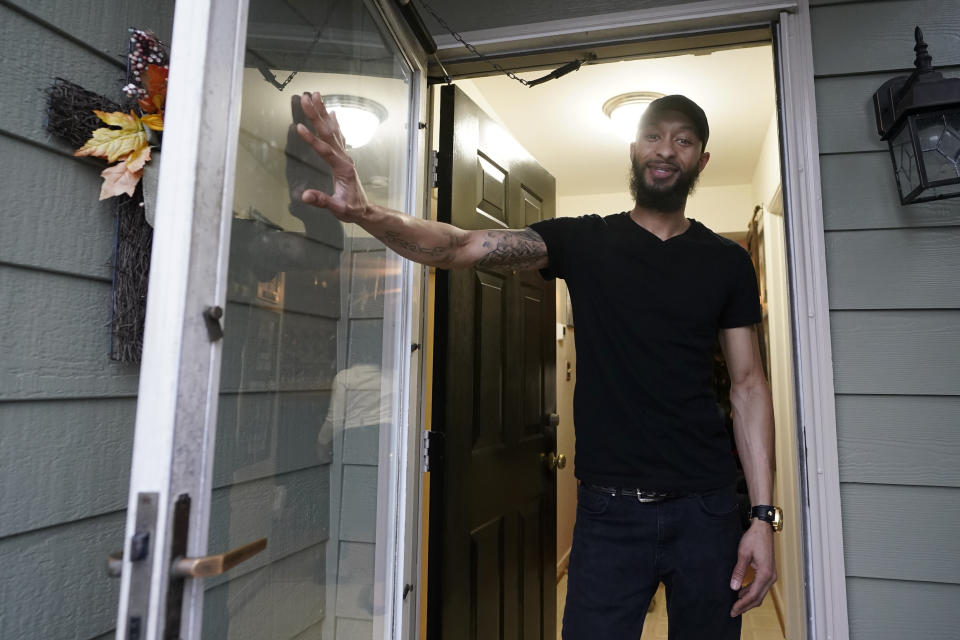 Richard Coleman II poses in his home in Richmond, Va., Thursday, Feb. 11, 2021. Coleman said he was asked to leave four jobs and was taken out of the running for at least six others because of his convictions for possessing a fraction of an ounce of marijuana, once as a college student in 2003 and a second time a few years later. (AP Photo/Steve Helber)
