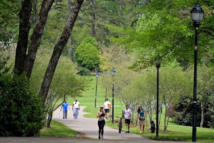 Mecklenburg County residents are still allowed to use the parks, as in here at Freedom Park, but social-distancing is expected. County officials recently closed off parking at the parks, intended to discourage groups from congregating.
