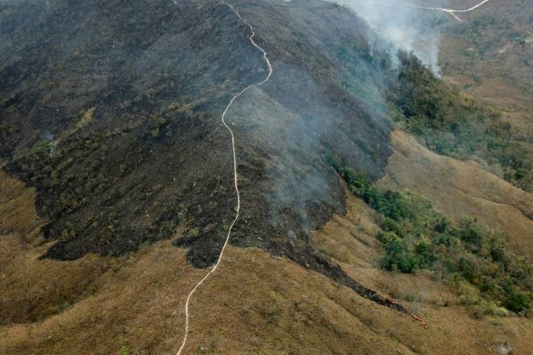 Handout aerial picture released by the Mato Grosso Fire Department showing burnt areas of land in the hills of the municipality of Chadapa dos Guimaraes in Mato Grosso State, in west-central Brazil, on August 23, 2019 (AFP Photo/HO)