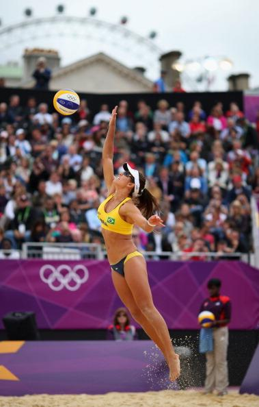 LONDON, ENGLAND - JULY 31: Maria Antonelli of Brazil dives for a shot during the Women's Beach Volleyball Preliminary match between Brazil and Germany on Day 4 at Horse Guards Parade on July 31, 2012 in London, England.  (Photo by Ryan Pierse/Getty Images)