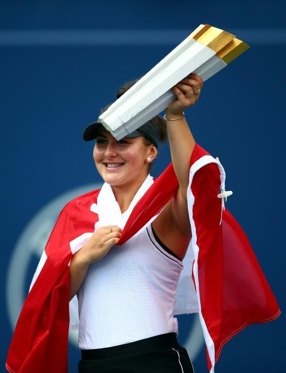 Home favorite: Bianca Andreescu brandishes her trophy after becoming the first Canadian in 50 years to win the WTA Toronto title (AFP Photo/Vaughn Ridley)