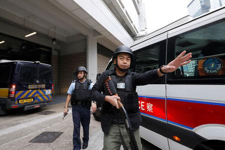 Armed policemen guard the entrance as a prison car carrying British former banker Rurik Jutting enters High Court to launching his appeal, in Hong Kong, China December 12, 2017. REUTERS/Tyrone Siu