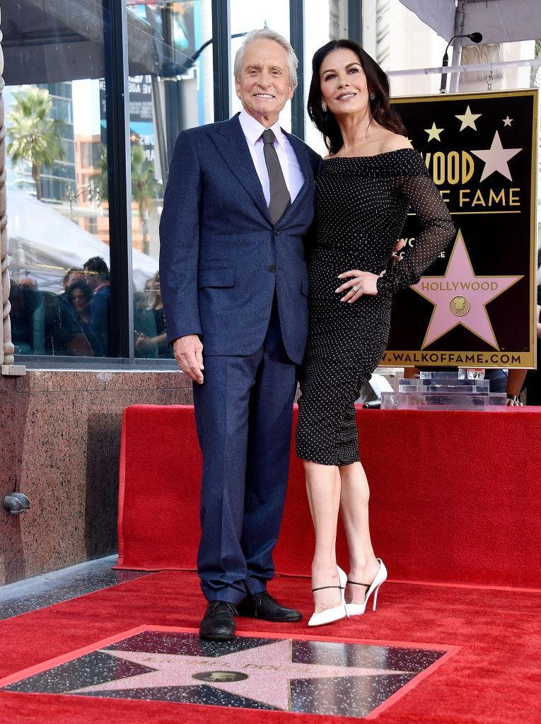 Michael Douglas and Catherine Zeta-Jones pose for a photo as he receives his star on the Hollywood Walk of Fame on Nov. 6, 2018, in Hollywood, Calif. (Photo: Gregg DeGuire/Getty Images)