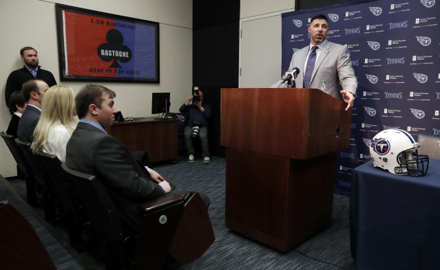 New Tennessee Titans head football coach Mike Vrabel, right, answers questions during a news conference, attended by his family, Monday, Jan. 22, 2018, in Nashville, Tenn. The Titans hired Vrabel, formerly the Houston Texans defensive coordinator, five days after firing Mike Mularkey. (AP Photo/Mark Humphrey)