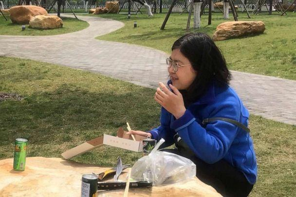 PHOTO: In this photo taken April 14, 2020 and released by Melanie Wang, Zhang Zhan eats a meal at a park during a visit to Wuhan in central China's Hubei province.  (AP)