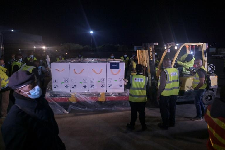 Some of the first batches of the Covid-19 vaccines arrive in Kenya to be loaded onto temperature-controlled trucks for transportation to a cold-storage facility in Nairobi