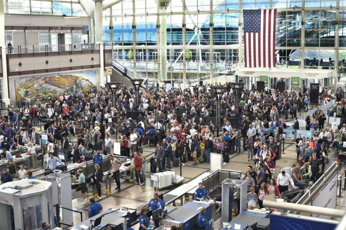 """<span class=""""caption"""">Airplane passengers line up for TSA security screenings at Denver International Airport in 2019.</span> <span class=""""attribution""""><a class=""""link rapid-noclick-resp"""" href=""""https://www.gettyimages.com/detail/news-photo/airplane-passengers-line-up-for-tsa-security-screenings-at-news-photo/1159430281?adppopup=true"""" rel=""""nofollow noopener"""" target=""""_blank"""" data-ylk=""""slk:Robert Alexander/Getty Images"""">Robert Alexander/Getty Images</a></span>"""