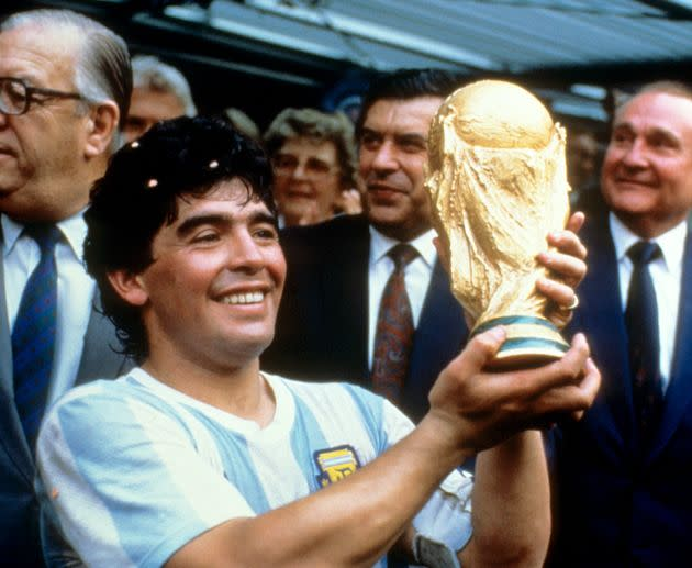 Diego Maradona holds up the World Cup trophy in 1986.