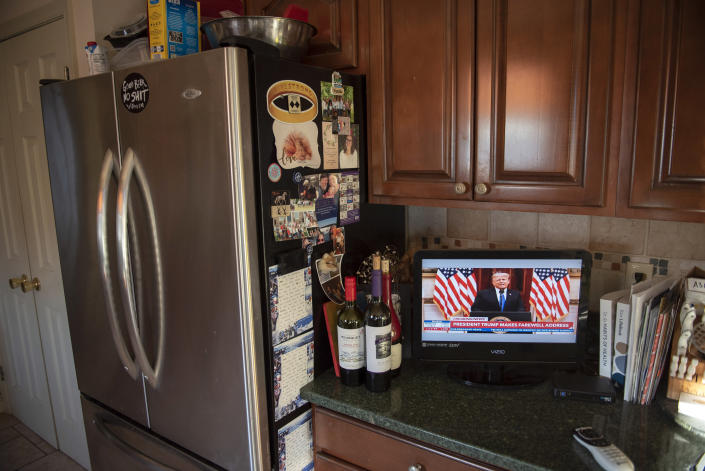 Natalie Abbas keeps two televisions on, one tuned to Newsmax and the other to FoxNews, in her home in Myersville, Md., Tuesday, Jan. 19, 2021, the day before the presidential inauguration. As a member of Braver Angels, Abbas, who believes the election was stolen, meets regularly with a neighbor who cheers Biden as the rightful winner, to ponder the greatest challenge facing Biden and American society: how can they find common ground if they no longer exist in the same reality? (AP Photo/Cliff Owen)