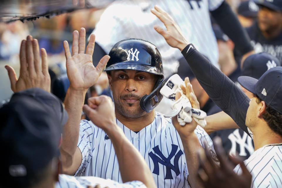New York Yankees' Giancarlo Stanton celebrates with his teammates after scoring on a sacrifice fly by Gleyber Torres during the second inning of a baseball game Thursday, Aug. 5, 2021, in New York. (AP Photo/Mary Altaffer)