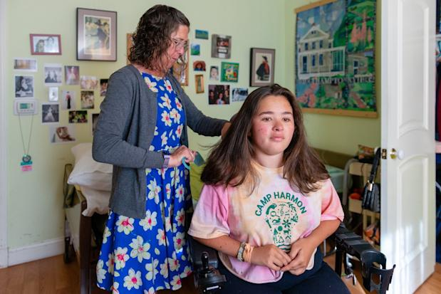 Amy Colt combs her daughter's hair before heading to a school function at Stanford University, which Sylvia will attend in the fall.