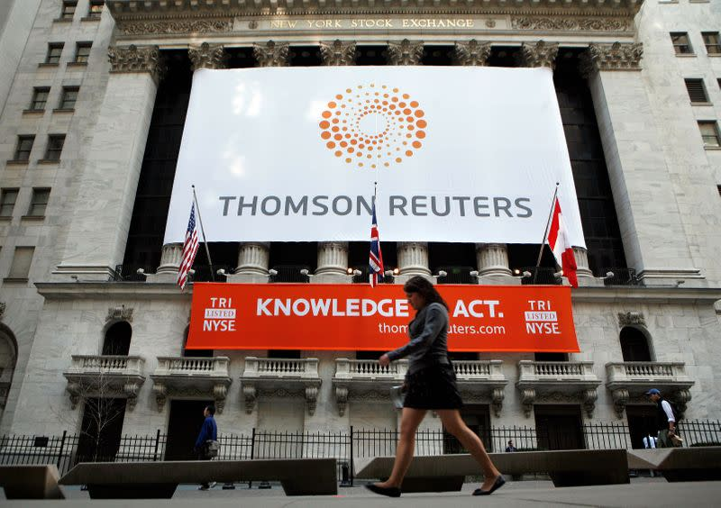 FILE PHOTO: The front of The New York Stock Exchange displays the new Thomson Reuters logo as the stock is traded for the first time in New York