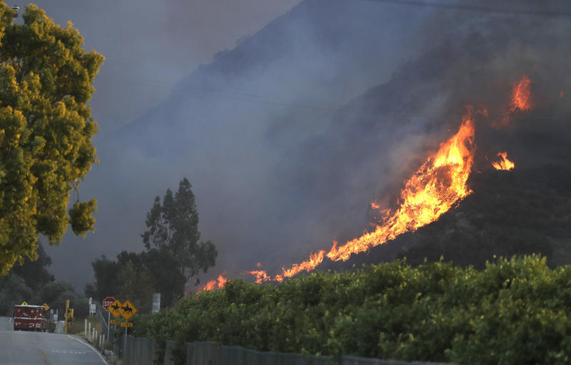 A wildfire comes down from a hilltop near Newbury Park, Calif., onNov. 8. (ASSOCIATED PRESS)