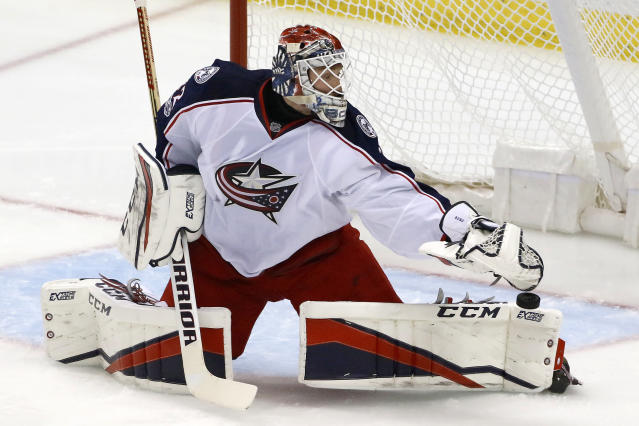 Columbus Blue Jackets goalie Sergei Bobrovsky blocks a shot during the first period in Game 5 of the team's NHL first-round hockey playoff series against the Pittsburgh Penguins in Pittsburgh, Thursday, April 20, 2017. (AP Photo/Gene J. Puskar)