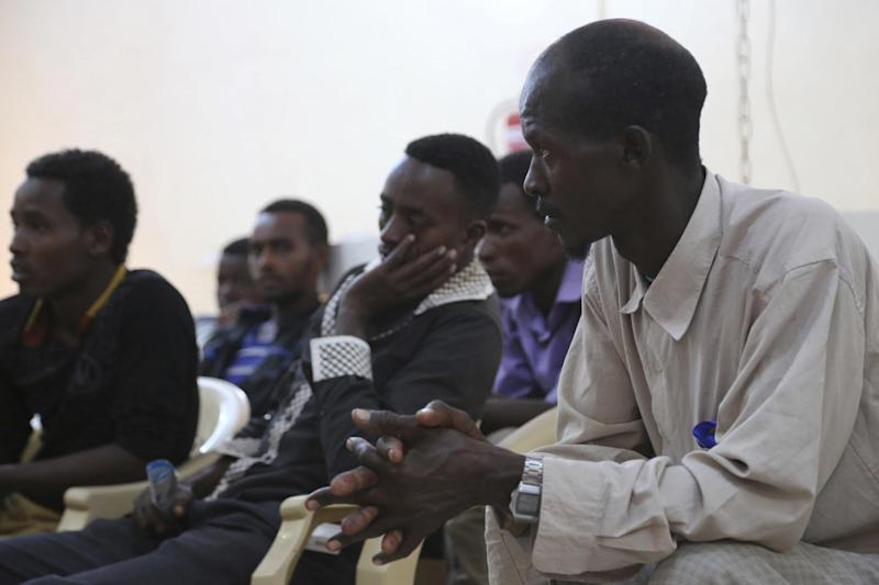 In this photo taken on Monday, Jan. 2, 2017, Ethiopian migrants gather at International Organization of Migration center in the port city of Aden, Yemen. Despite Yemen's civil war, migrants from Ethiopia and Saudi Arabia are streaming in, hoping to make their way to wealthy Saudi Arabia. Instead, they often meet torture, rape and imprisonment at the hands of smugglers. (AP Photo/Maad Al-Zikry)
