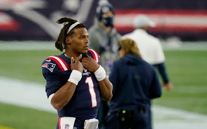 New England Patriots quarterback Cam Newton watches from the sideline after being replaced by Jarrett Stidham in the second half of an NFL football game against the San Francisco 49ers, Sunday, Oct. 25, 2020, in Foxborough, Mass. - AP
