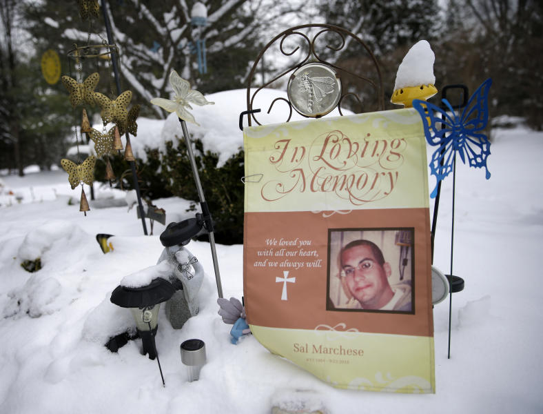 In this Monday, March 17, 2014 photo, a banner and ornaments commemorate Salvatore Marchese in a memorial outside the home of his mother, Patty DiRenzo, in Blackwood, N.J. Salvatore died from an overdose of heroin in 2010. Salvatore was denied admission to treatment facilities again and again, often because his insurance company wouldn't cover the cost. (AP Photo/Mel Evans)