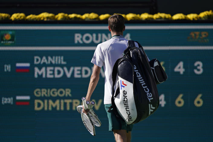 Daniil Medvedev, of Russia, walks off the court after losing to Grigor Dimitrov, of Bulgaria, at the BNP Paribas Open tennis tournament Wednesday, Oct. 13, 2021, in Indian Wells, Calif. (AP Photo/Mark J. Terrill)