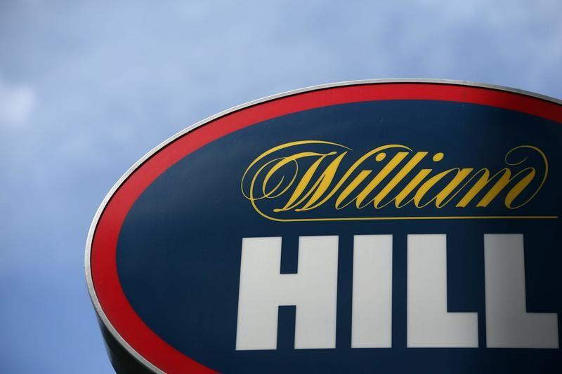 A branded sign is displayed outside a William Hill betting shop in London