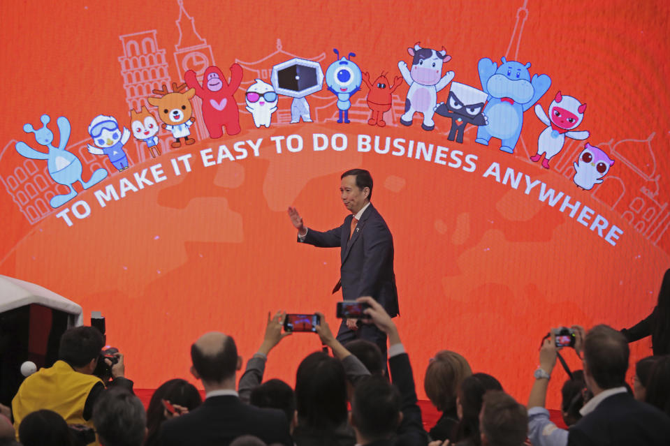 Chairman and CEO of Alibaba Group Daniel Zhang Yong attends the Alibaba Group's listing ceremony at the Hong Kong Stock Exchange (HKEX) in Hong Kong, Tuesday, Nov. 26, 2019. (AP Photo/Kin Cheung)