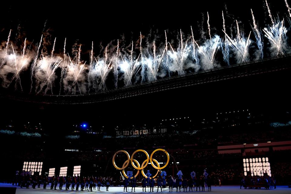 <p>Fireworks went off as dancers performed in front of the Olympic rings at the opening ceremony. </p>