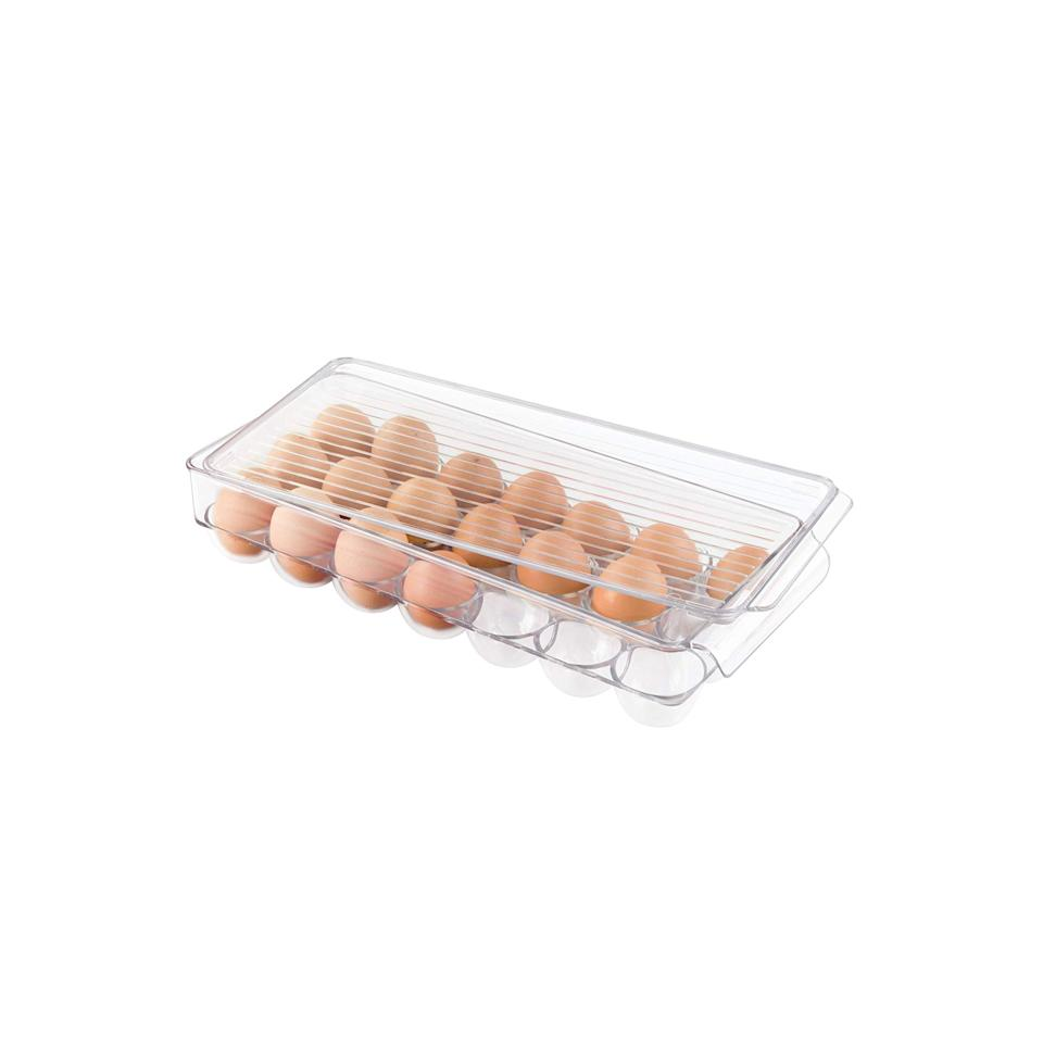 """<p>Instantly create more space in your cramped fridge with these ventilated storage bins that slide right onto the shelves. Give eggs, cheese, and fruit their own designated space within your refrigerator. You can even use this colorful storage solution for the freezer, cabinets, or pantry for more space saving functionality.</p> <p><strong>To buy: </strong>From $27; <a href=""""https://www.amazon.com/mDesign-Refrigerator-Freezer-Storage-Organizer/dp/B01E4DSBT0/ref=asc_df_B01E4DSBT0/?ie=UTF8&camp=1789&creative=9325&linkCode=as2&creativeASIN=B01E4DSBT0&tag=reasim03-20&ascsubtag=d41d8cd98f00b204e9800998ecf8427e"""" target=""""_blank"""">amazon.com</a>. </p>"""
