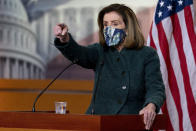 House Speaker Nancy Pelosi of Calif. calls on a reporter at a news conference on Capitol Hill in Washington, Thursday, Jan. 28, 2021. (AP Photo/Andrew Harnik)