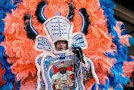 "<p>This tradition began when African Americans, who were once kept out of many mainstream krewes, began throwing parades of their own. The outfit is <a href=""https://www.neworleans.com/things-to-do/music/history-and-traditions/mardi-gras-indians/"" rel=""nofollow noopener"" target=""_blank"" data-ylk=""slk:a nod to the Native Americans who helped protect enslaved people running for freedom"" class=""link rapid-noclick-resp"">a nod to the Native Americans who helped protect enslaved people running for freedom</a>. </p>"