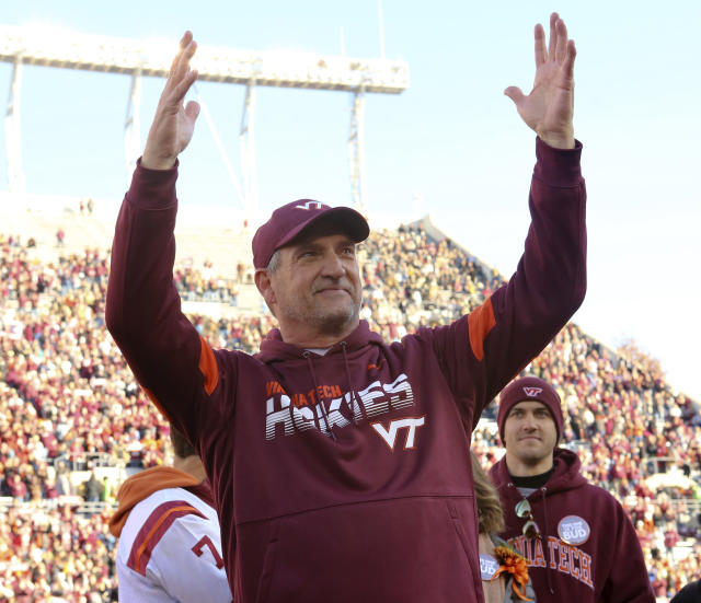 Virginia Tech defensive coordinator Bud Foster, who is retiring after the season, gestures as he is honored before the team's NCAA college football game against Wake Forest on Saturday, Nov. 9, 2019, in Blacksburg, Va. (Matt Gentry/The Roanoke Times via AP)