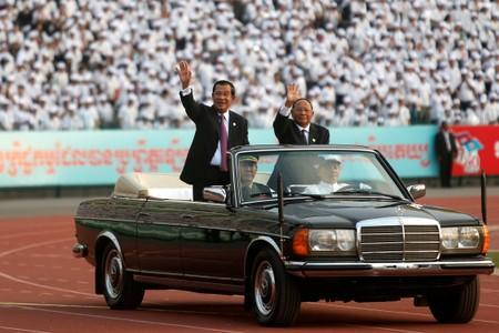 FILE PHOTO: Cambodia's Prime Minister Hun Sen arrives at an event to mark the 40th anniversary of the toppling of Pol Pot's Khmer Rouge regime at the Olympic stadium in Phnom Penh,