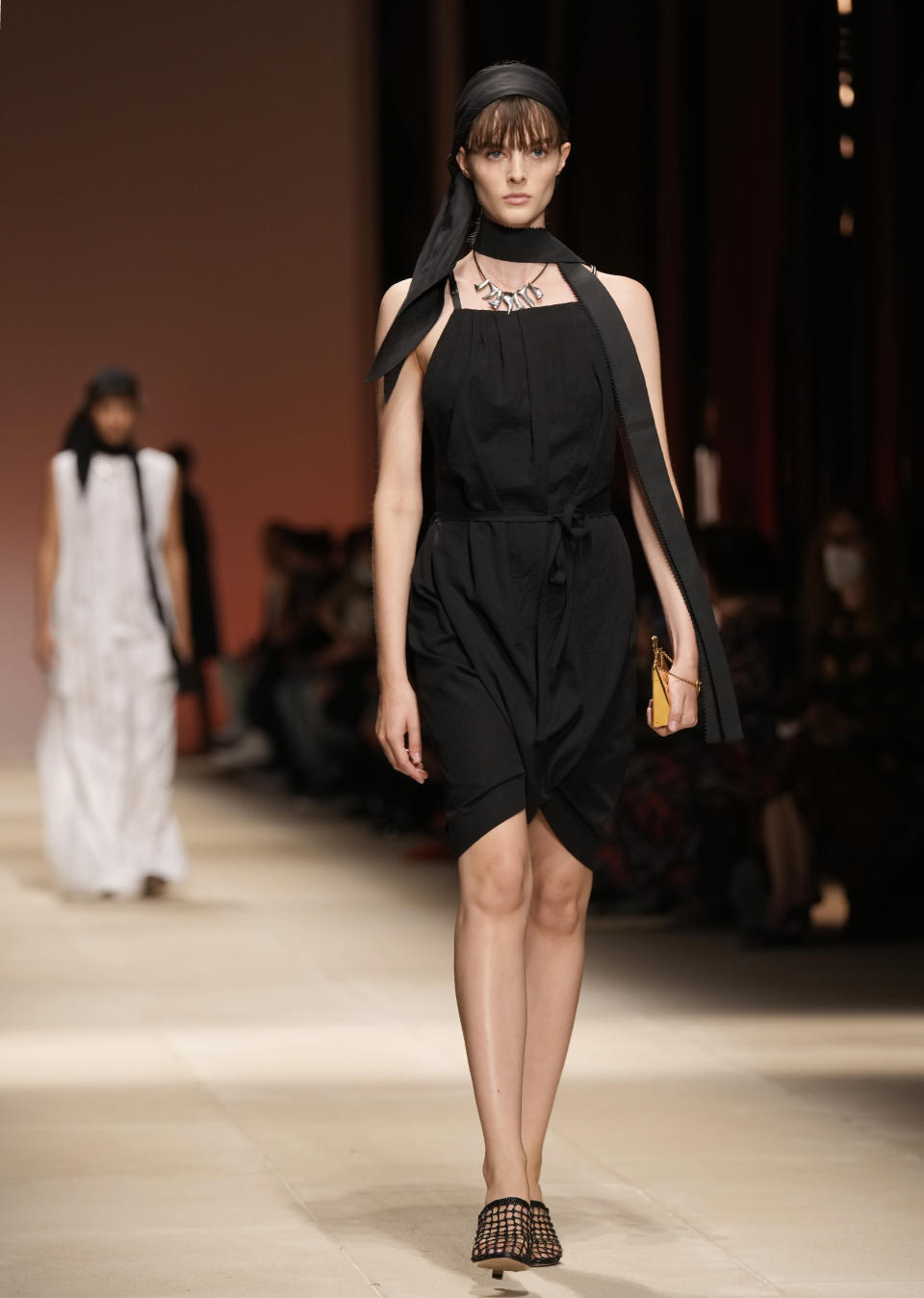 A model wears a creation as part of the Salvatore Ferragamo women's and men's Spring Summer 2022 collection, unveiled during the Fashion Week in Milan, Italy, Saturday, Sept. 25, 2021. (AP Photo/Antonio Calanni)