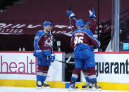 Colorado Avalanche left wing Gabriel Landeskog (92) celebrates with Pierre-Edouard Bellemare (41) and Mikko Rantanen (96) after the team's win pver the Los Angeles Kings in an NHL hockey game Thursday, May 13, 2021, in Denver. (AP Photo/Jack Dempsey)