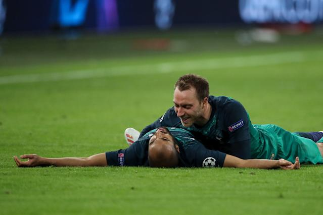 Lucas Moura and Christian Eriksen celebrate at full-time (Photo by Matthew Ashton - AMA/Getty Images)