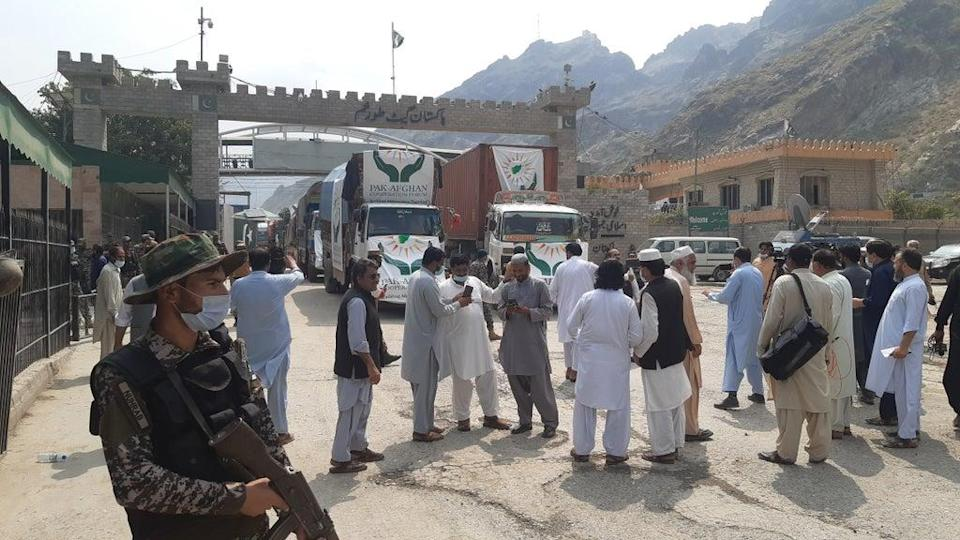 Taliban and Pakistani security keep guard at Torkham border crossing as Afghans wait for the reopening of the border gate to enter Pakistan (Anadolu Agency via Getty Images)