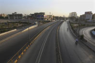 Roads are deserted due to a lockdown to help control the spread of the coronavirus, in Karachi, Pakistan, Sunday, May 9, 2021. (AP Photo/Fareed Khan)