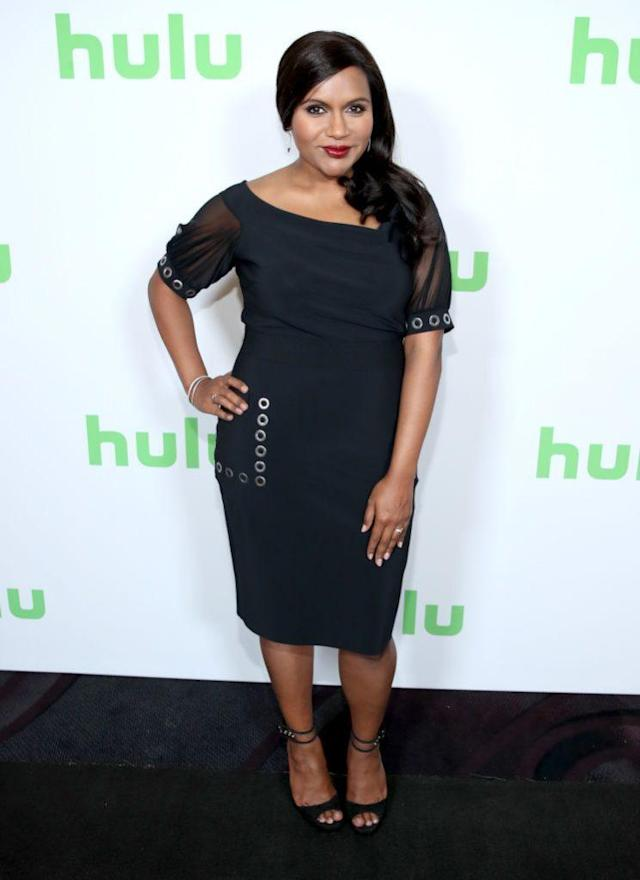 Mindy Kaling wore a curve-hugging black dress to TCA summer press tour. (Photo: Getty Images)