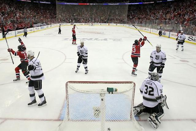 NEWARK, NJ - JUNE 09: Alexei Ponikarovsky #12 and David Clarkson #23 of the New Jersey Devils celebrate after Bryce Salvador #24 scores a goal in the second period against Jonathan Quick #32 of the Los Angeles Kings during Game Five of the 2012 NHL Stanley Cup Final at the Prudential Center on June 9, 2012 in Newark, New Jersey. (Photo by Elsa/Getty Images)