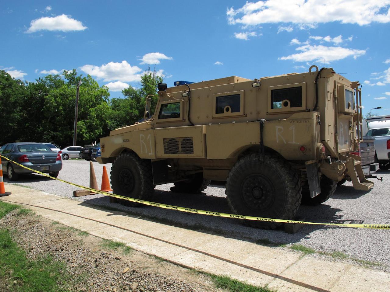 An armored vehicle sits in the parking lot of a command center set up to coordinate the search for two Tennessee girls and the man accused of abducting them and killing their mother and sister on Thursday May 10, 2012, in Guntown, Miss. The hunt for Adam Mayes and the two young sisters he is accused of kidnapping has encompassed parts of at least three counties in northern Mississippi. (AP Photo/Adrian Sainz)